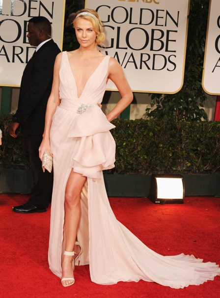 Charlize Theron in Dior Couture at the Golden Globes--always flawless and interesting. the accents are also flawless....i love the 20's cartier inspired headband. also, she has legs for days!