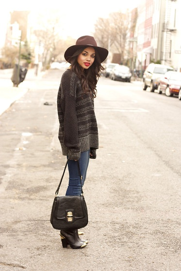 Super cozy and fashion forward, this wide brimmed hat helps elevate the look.