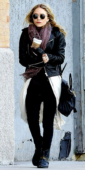 Mary Kate Olsen the Queen of layering pairs an oversized duster sweater with a short leather jacket for a perfectly proportioned outfit.