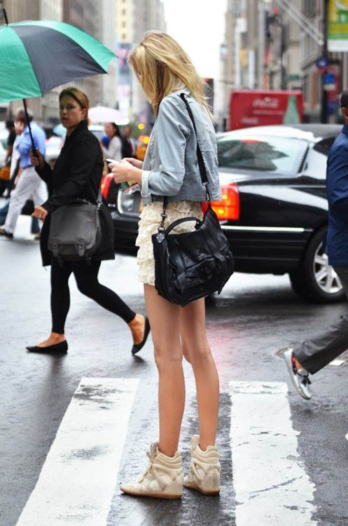 I love the feminine skirt, white washed denim and of course wedge sneakers!