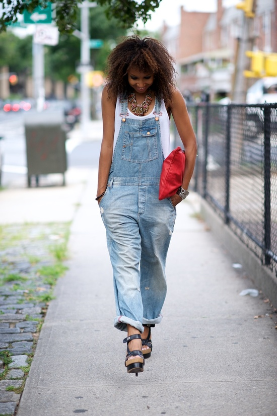 A great way to make overalls your own is by adding a statement necklace and an unexpected pop of color
