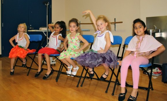 The child models working it backstage